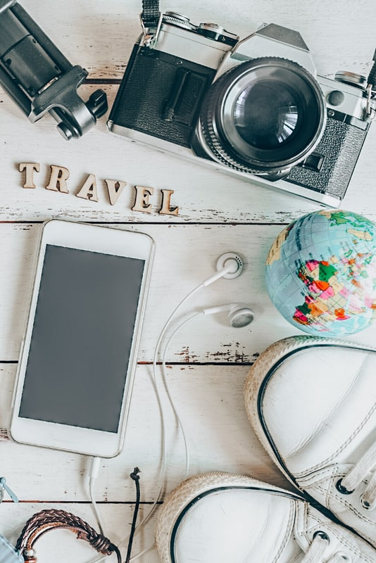 How to start your travel fund with travel essentials phone camera headphones