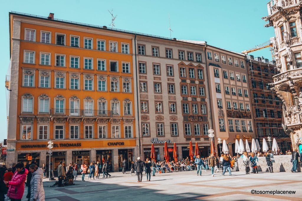 Scenes from Mary's Square in Old town Munich. A week long itinerary to Munich, Germany. Read a day-by-day list of popular places to visit like Marienplatz, day trips from Munich to Nuremberg, Dachau and the Bavarian countryside Use this itinerary to craft your own special Munich trip and inspirations #munich #germany #itinerarytomunich