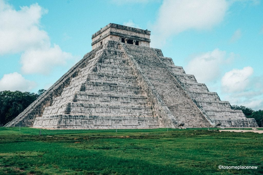 El Castillo at Chichen Itza - Exploring the Mayan Ruins of Chichen Itza, Mexico. Read all about its history, travel tips and itinerary. A quick guide to Chichen Itza, one of the wonders of the modern world.