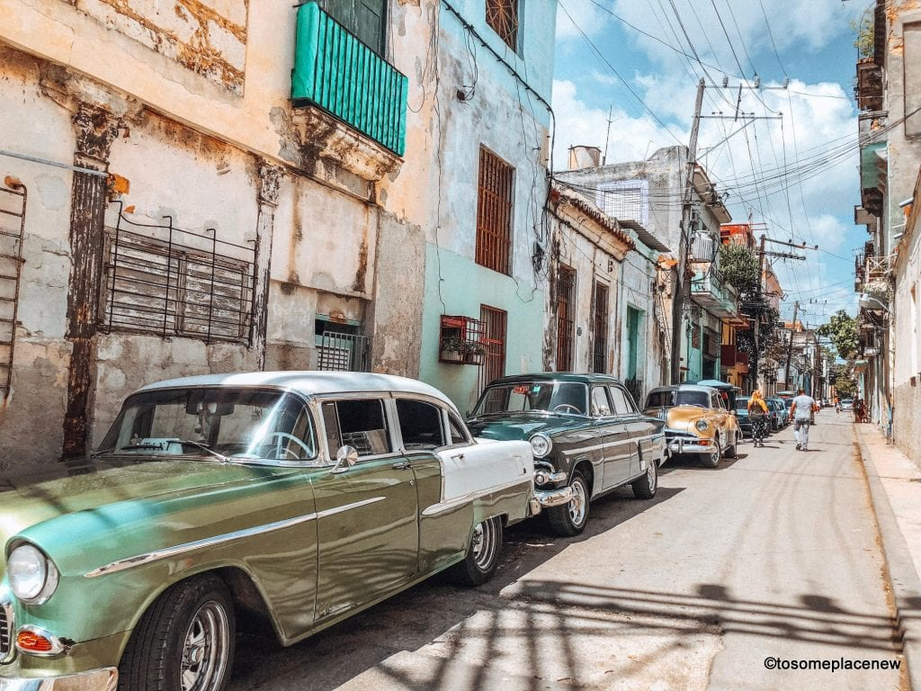 Classic cars in Old Havana Cuba. Things to know before traveling to Cuba. Get all the Cuba tips and advice - visa requirements, currency, health and safety, packing tips, hotels & more