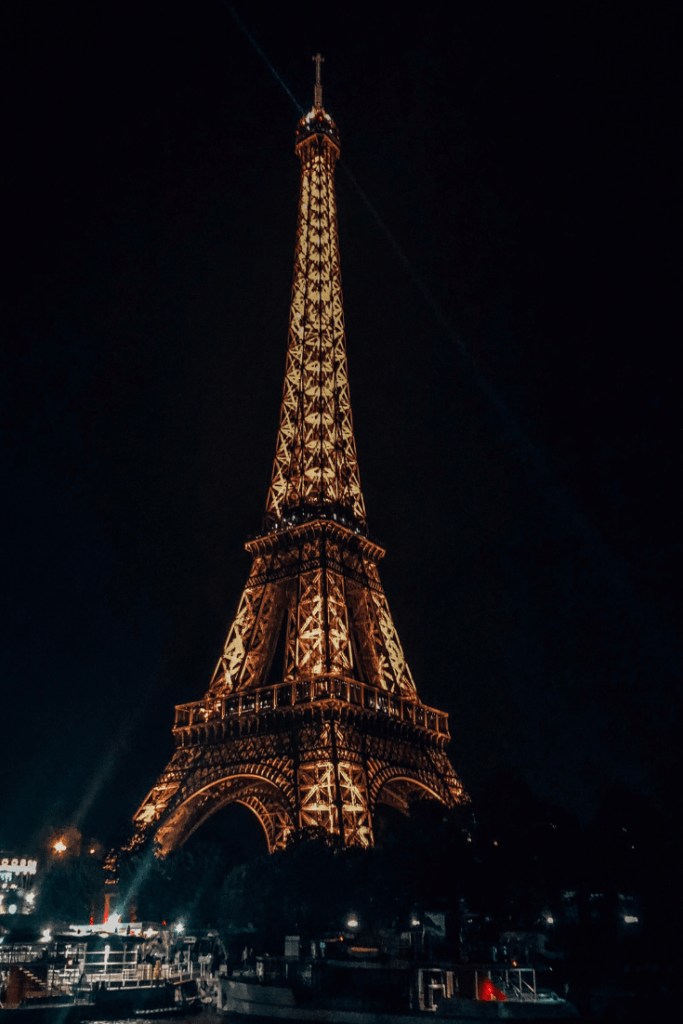 View of the Eiffel Tower from Seine River Cruise at night