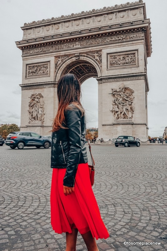 Arc de Trioumphe Girl in red dress Perfect 4 day Paris Itinerary - Experience the best in sightseeing with things to do in 4 days in Paris, what to eat, where to stay and other travel tips