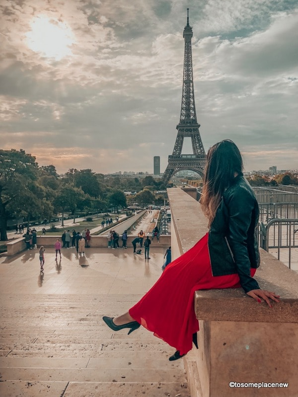 Girl at the Eiffel tower in a Perfect 4 day Paris Itinerary - Experience the best in sightseeing with things to do in 4 days in Paris, what to eat, where to stay and other travel tips