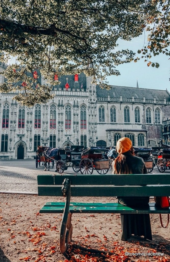 The Burg Square. Get ready to be mesmerized by gingerbread houses, medieval Markt Square, romantic canal tour, Belgian waffles and beer tour in one day in Bruges Itinerary.