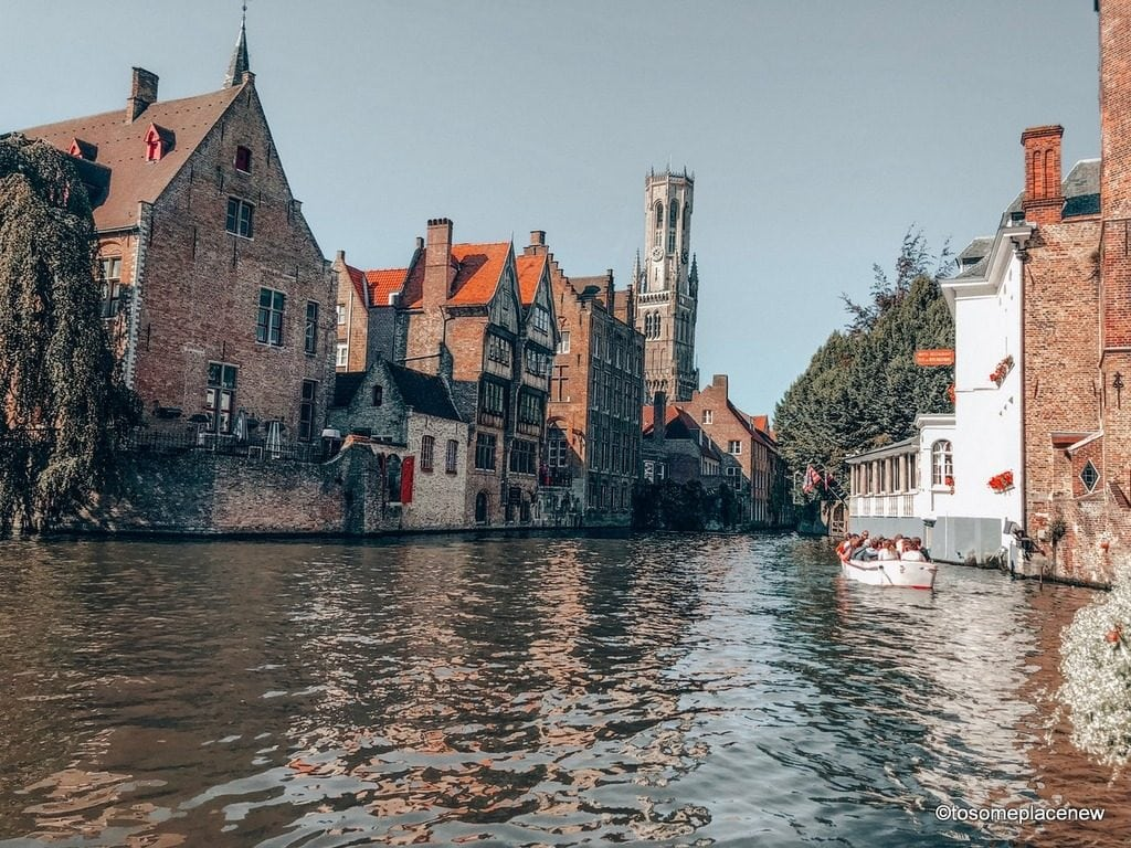 Canal Tour in Bruges. Get ready to be mesmerized by gingerbread houses, medieval Markt Square, romantic canal tour, Belgian waffles and beer tour in one day in Bruges Itinerary.