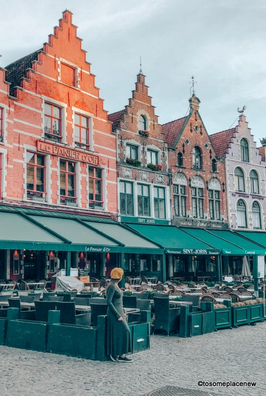 Markt Square Bruges. Get ready to be mesmerized by gingerbread houses, medieval Markt Square, romantic canal tour, Belgian waffles and beer tour in one day in Bruges Itinerary.