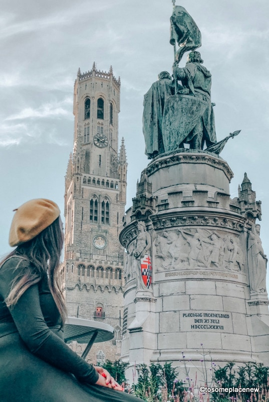 Statues at the Markt Square. Get ready to be mesmerized by gingerbread houses, medieval Markt Square, romantic canal tour, Belgian waffles and beer tour in one day in Bruges Itinerary.