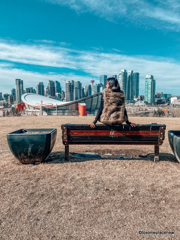 Ultimate things to do in Downtown Calgary- Girl soaking in views of Downtown from Scotsmen Hill