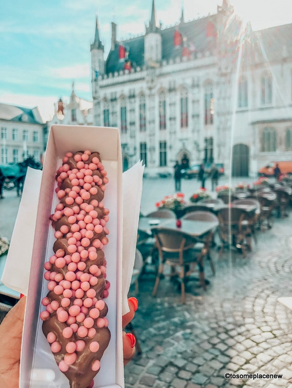 Waffle on a Stick - Get ready to be mesmerized by gingerbread houses, medieval Markt Square, romantic canal tour, Belgian waffles and beer tour in one day in Bruges Itinerary.