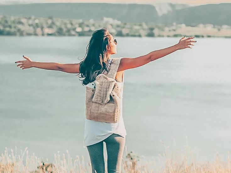 Girl with Best Sling Backpack for Travel