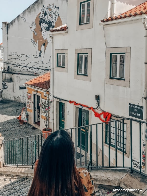 Girl admiring Lisbon photography spots and art