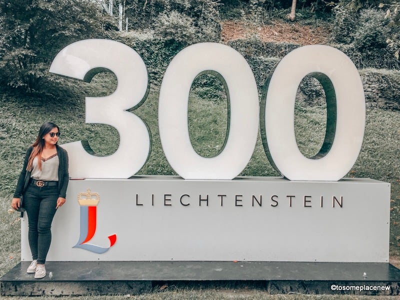 Mayuri at Liechtenstein Welcome sign