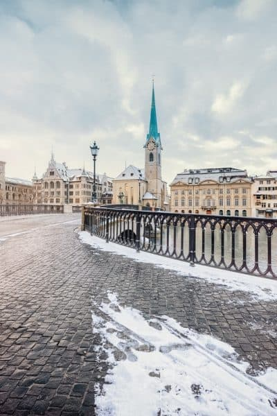 Winter landscape of Zurich with lake with bridge on foreground, Switzerland
