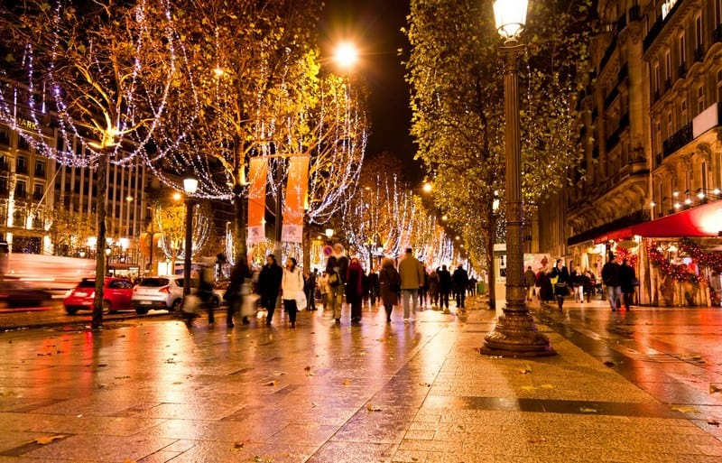Famous shopping district Champs Elysees illuminated with Christmas light in Paris
