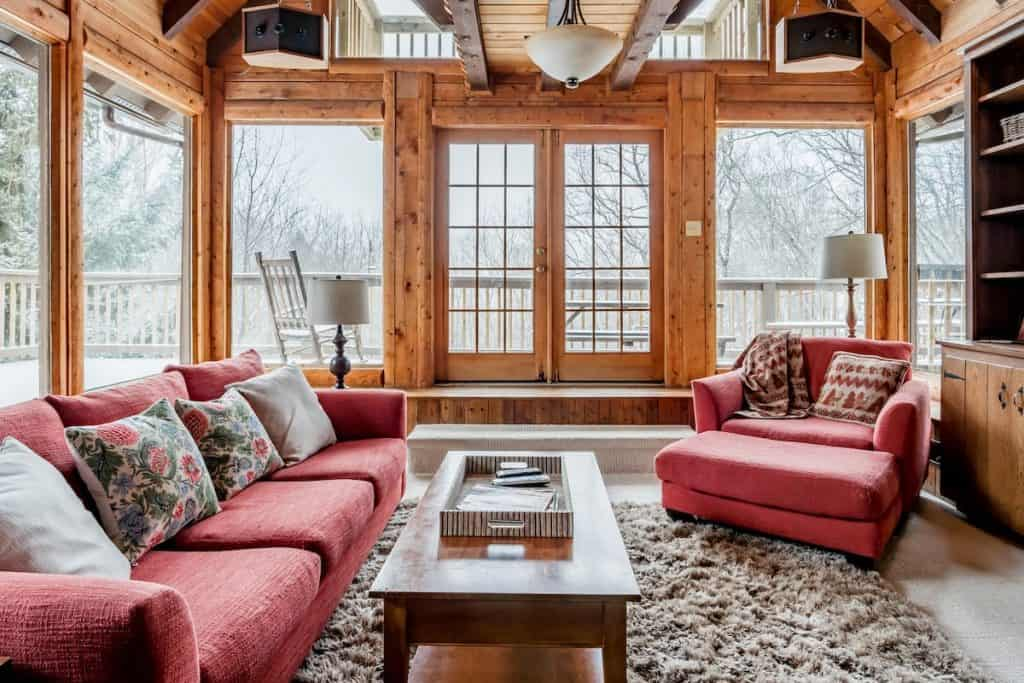 Living room of a rustic chic log cabin in Boone Airbnb