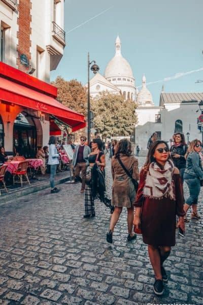 Girl on cobblestone lanes in Montmartre Paris