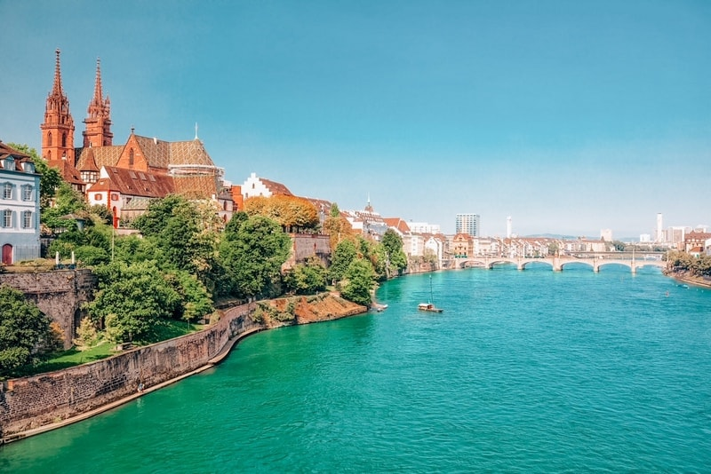 The old city center of Basel with Munster cathedral and the Rhine river, Switzerland, Europe. Basel is a city in northwestern Switzerland on the river Rhine and third-most-populous city.