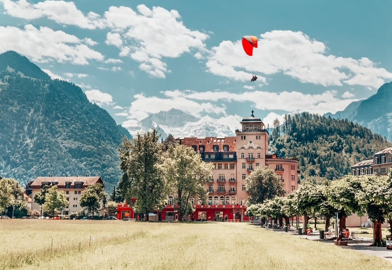 Paragliding Interlaken in summer. One of the popular and best time to go to Switzerland