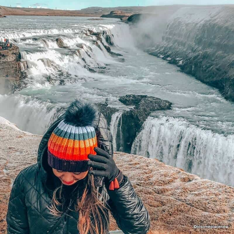Girl wearing a colorful beanie in Iceland in winter months. Iceland packing List