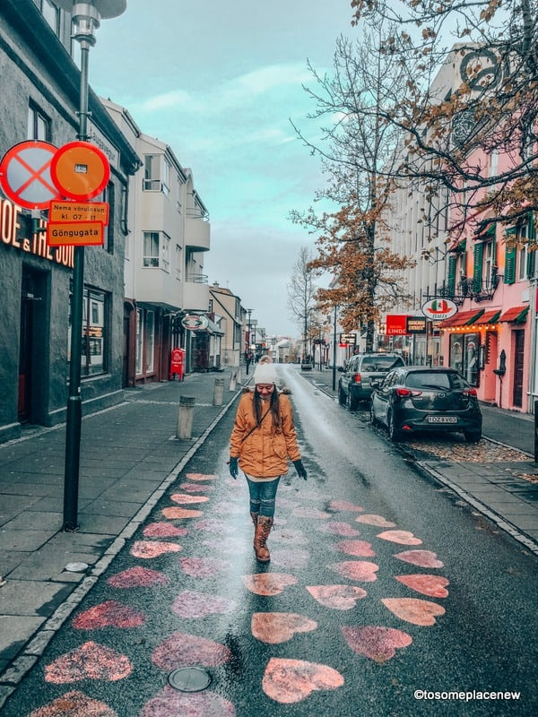 Girl in Reykjavik with a guide to spending One day in Reykjavik Itinerary
