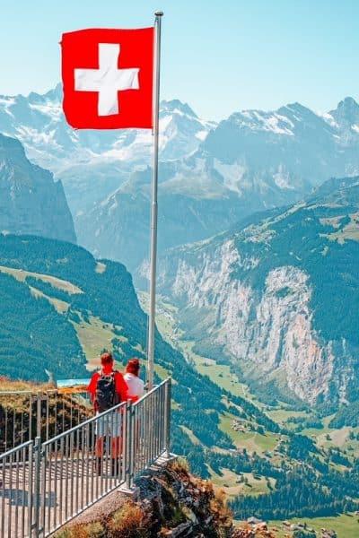 Swiss flag on the top of Mannlichen (Jungfrau region, Bern, Switzerland) Learn about planning a trip to Switzerland travel tips