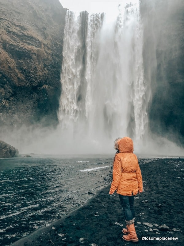 South Coast Tour - Girl at Skogafoss
