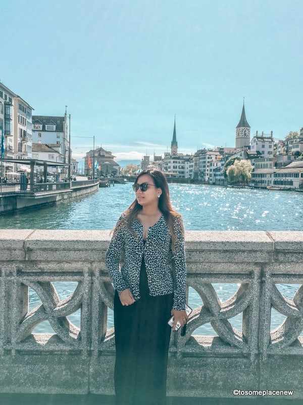 Switzerland packing list in the autumn. A girl wearing a romper with cardigan