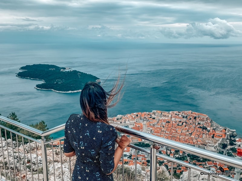 Girl in Dubrovnik taking in city views from the funicular