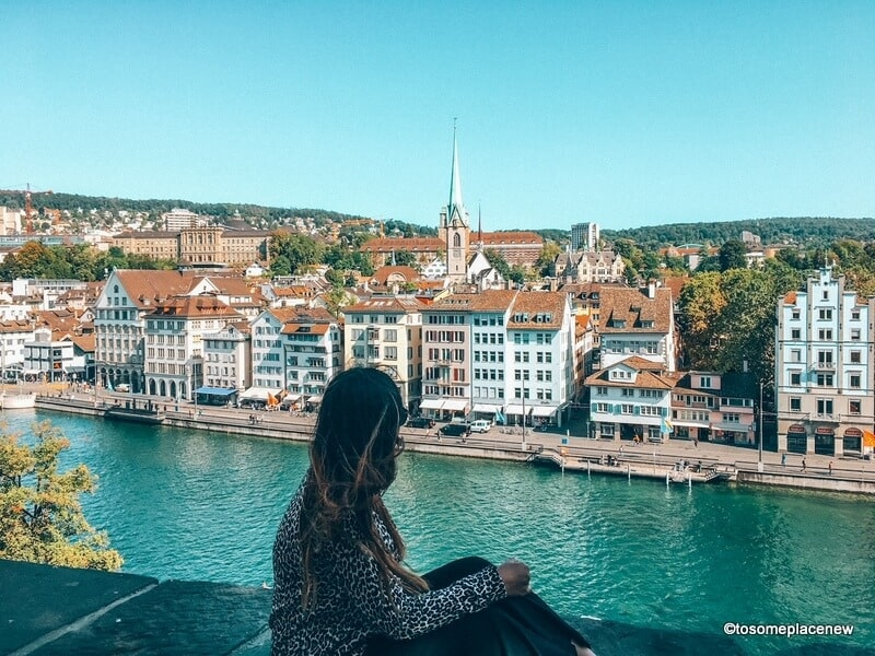 Girl in Zurich overlooking the old town