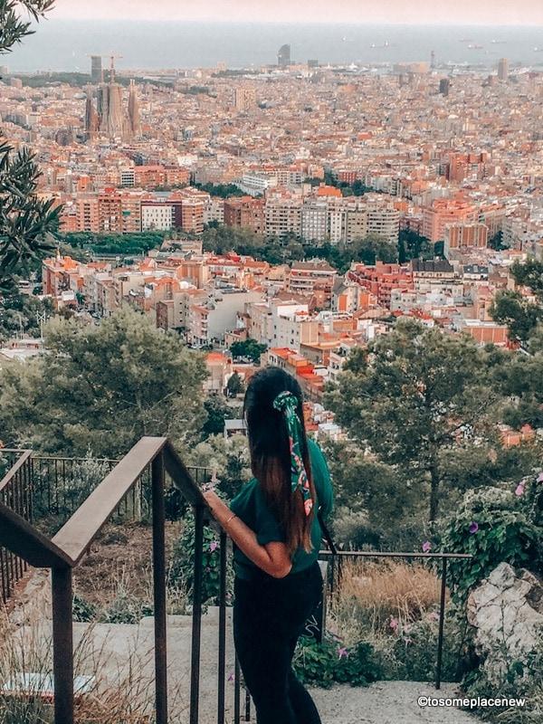 Girl looking admiring Barcelona skyline from Bunkers del Carmel