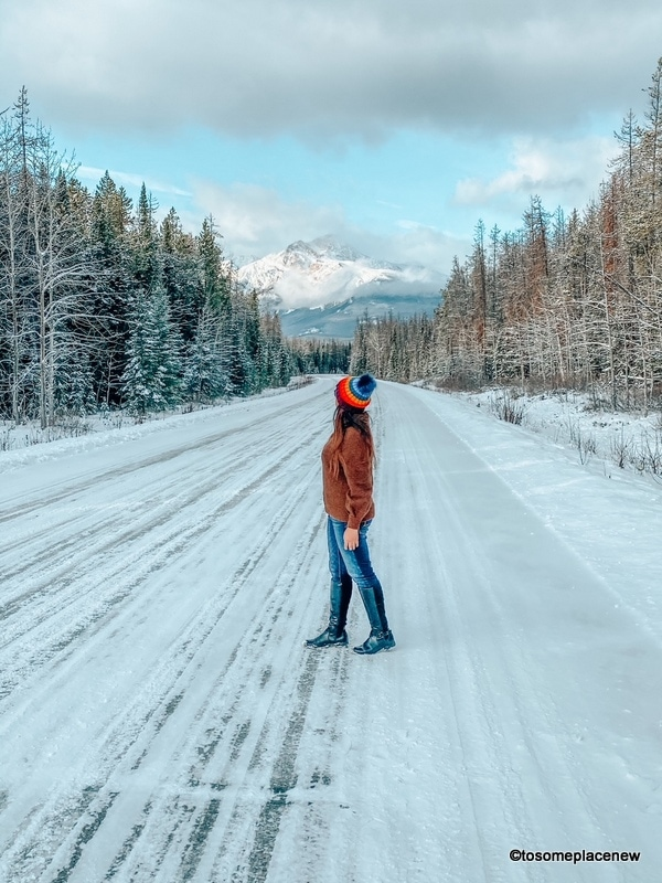 girl wearing colorful beanies in the cold